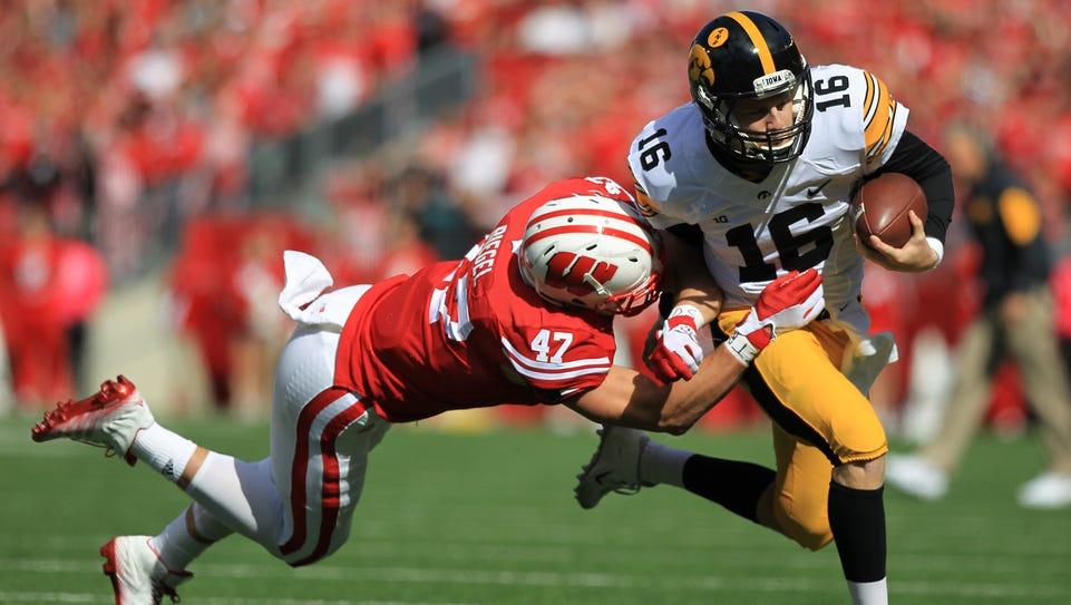 Iowa quarterback C.J. Beathard runs for a 16-yard gain