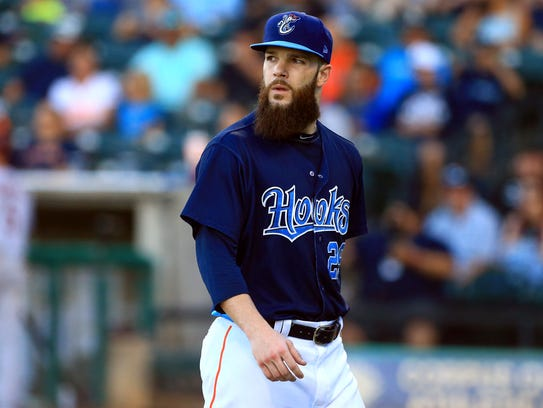 Hooks' Dallas Keuchel walks to the dugout after pitching