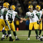 Green Bay Packers kicker Mason Crosby (2) is congratulated by his teammates after Crosby made a field goal against the Minnesota Vikings in the third quarter at TCF Bank Stadium in Minneapolis.