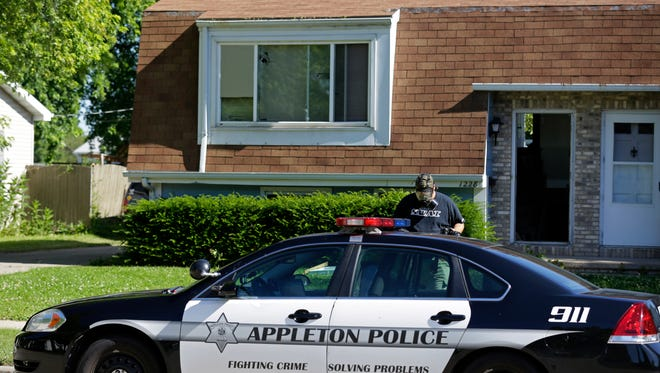The Appleton Police Department continues processing the scene in the 1200 block of East Sylvan Ave., Sunday, July 3, 2016 in Appleton, Wisconsin.