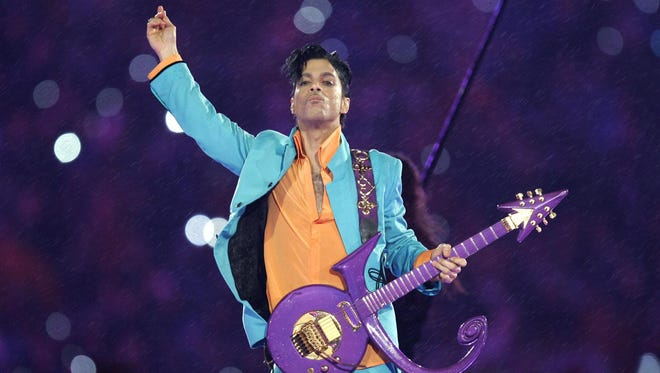 Prince performs during the halftime show on Feb. 4, 2007, at the Super Bowl XLI football game at Dolphin Stadium in Miami.