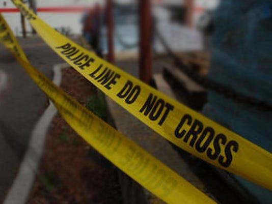 FTCBrd_11-23-2014_Coloradoan_1_A001~~2014~11~22~IMG_-crime_tape_edited.j_1_1_DO9