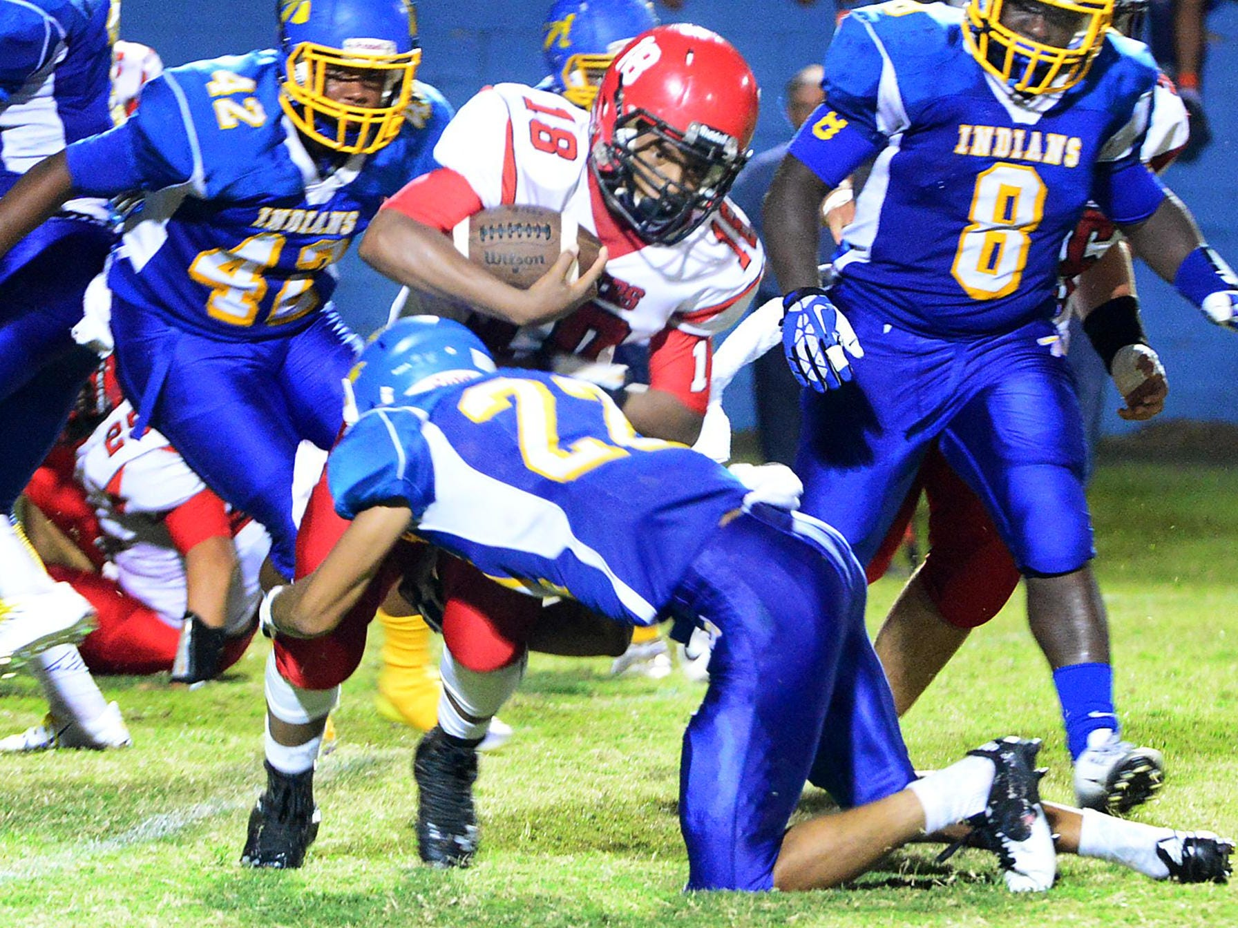 Lexington's De'Andre Scott is stopped by North Side's Jordan Winston on Friday evening at North Side.