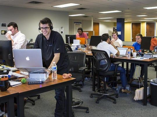Employees in SevOne's sales department work at the company's Pike Creek office in September 2015.