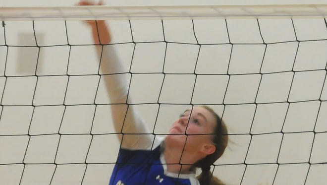 Gibraltar's Helen Hecht hits the ball over N.E.W. Lutheran defenders during Oct. 14 game in Green Bay.