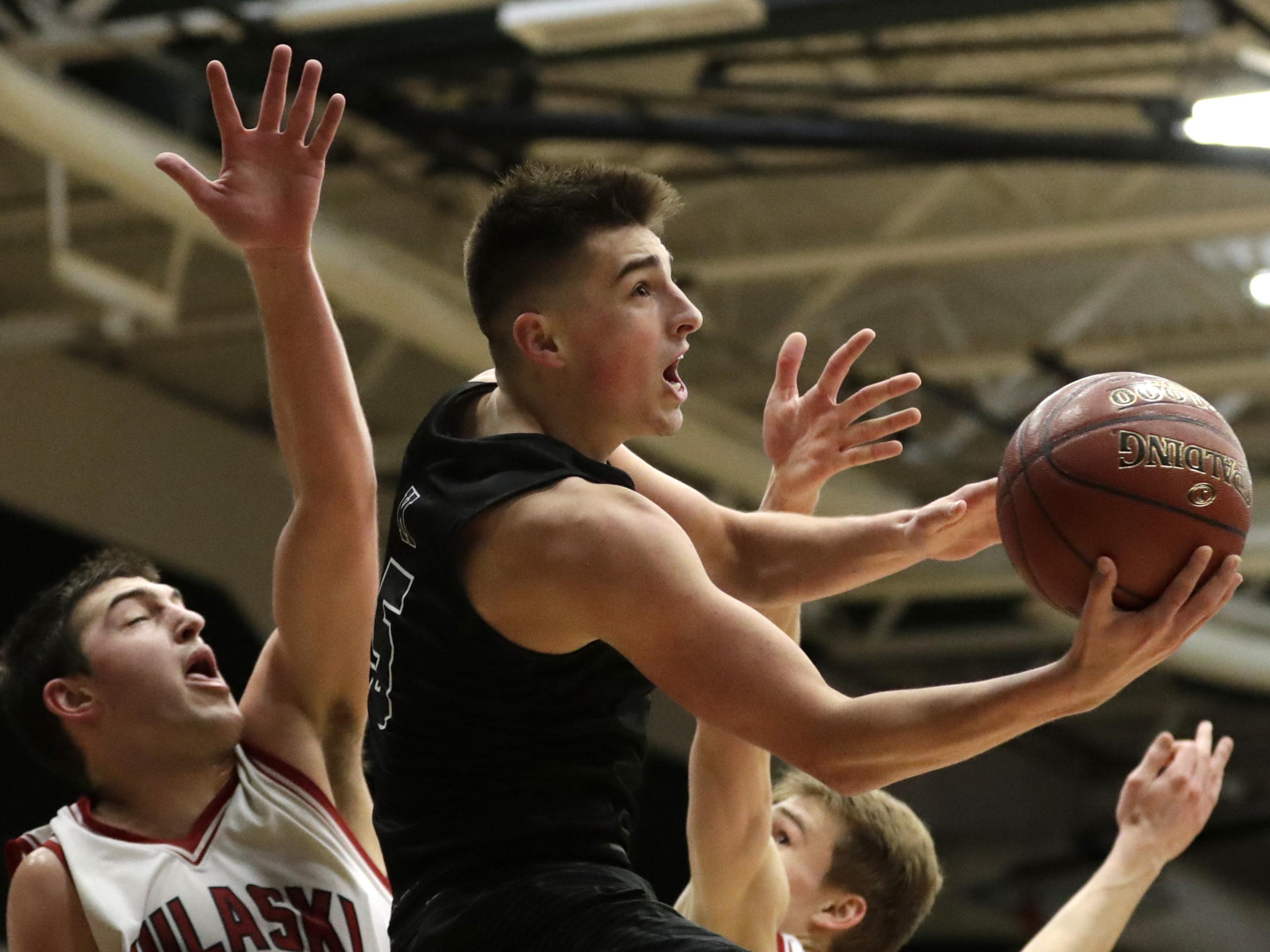 Kaukauna junior Jordan McCabe goes for a layup against Pulaski during their WIAA Division 2 sectional semifinal game Thursday at Ashwaubenon High School. McCabe finished with a game-high 32 points to lead the Galloping Ghosts to the win.