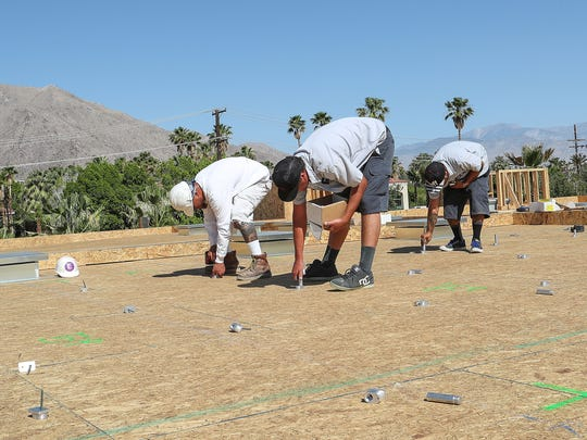 Solar technicians with Hot Purple Energy install solar stanchions on a new housing project under construction adjacent to the Riviera hotel in Palm Springs on May 15, 2018. The 64-unit development will have solar panels on all eight buildings.