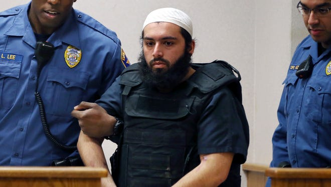 In this file photo from Tuesday, Dec. 20, 2016, Ahmad Khan Rahimi, the man accused of setting off bombs in New Jersey and New York in September is led into court in Elizabeth, N.J.