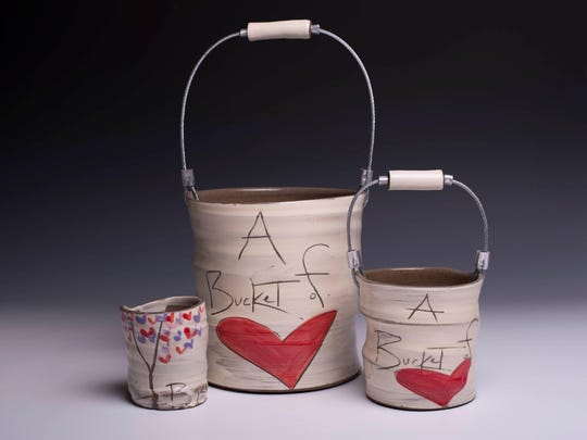 "Ceramic ""Buckets of Love"" and a ""Cup of Peace and Might"" by Erik and Noelle VanHendrick, featured in the Valentine's Show Feb. 4 at Plum Bottom Pottery & Gallery."