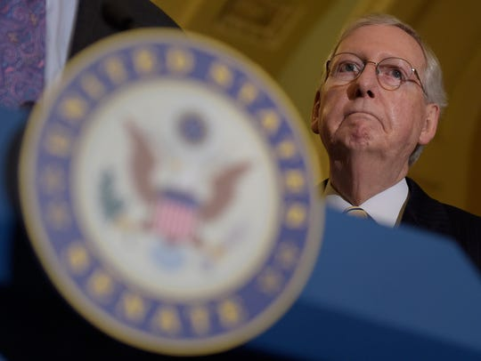 Senate Majority Leader Mitch McConnell of Ky., listens