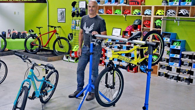 Bill Buckwalter, owner of Ride On, stands in a section of the Wooster bicycle shop usually stocked with new bikes. The store and others like it are experiencing a shortage due to increased demand and supply chain interruptions.
