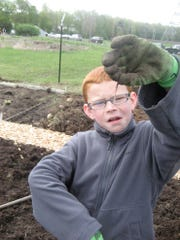 Braedyn Robson, 11, finds an earthworm at the Chatham Community Garden in 2010. The Robson family served on the volunteer committee.