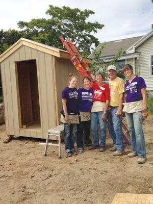 The writer (far right) with (from left) Beth Hershel, Michelle Gosney, Jean Maier and Erwin Mageary at the volunteer site.