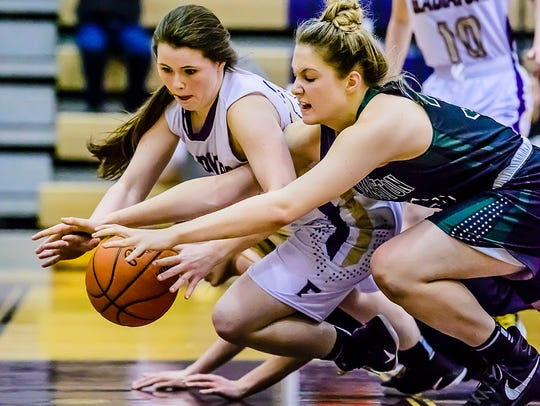 Fowlerville sophomore Jackie Jarvis (left) made second-team