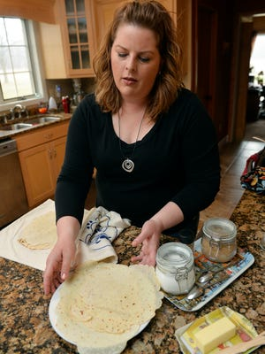 Amy Marquard sets out slices of freshly made lefse Thursday, March 17, in her rural Foley home. Marquard has designed three products to aid in the making of lefse.