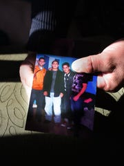 Jose Archaga held a photo of his brothers on Friday Sept. 29, 2017 in Dover, NJ. (From left) Santos Archaga, Daniel Archaga and Joel Archaga.
