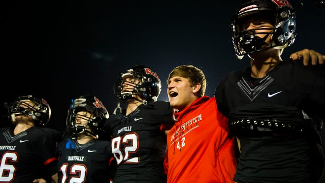 Maryville players listen to their alma mater after a high school first round playoff football game between Maryville High School and Bearden High School at Maryville Friday, Nov. 3, 2017. Maryville defeated Bearden 28-0.