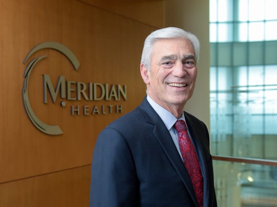 John Lloyd, president and CEO of Meridian Health, stands at Jersey Shore University Medical Center in Neptune.