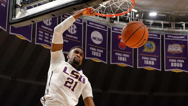LSU Tigers forward Aaron Epps (21) dunks the ball in the second half against Mississippi State Bulldogs guard Quinndary Weatherspoon (11) at Pete Maravich Assembly Center. Mandatory Credit: Stephen Lew-USA TODAY Sports