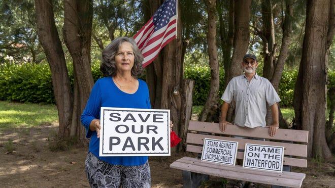 Pleasant Ridge Property Owners Association president Nancy Silvio Lodise and vice president Eric Casasus Monday in the neighborhood's de facto park in Juno Beach.