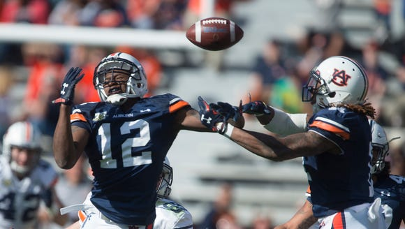 Auburn defensive back Jamel Dean (12) and Auburn linebacker