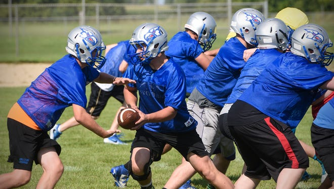 Foley's Jamie Gothman runs a play at quarterback during practice Tuesday, Aug. 15, at Foley High School.