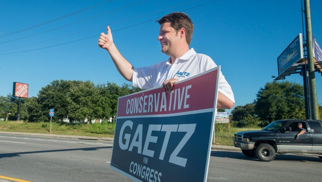 Matt Gaetz waves to passing cars at the intersection of Davis and Brent Lane on Primary Election Day in Pensacola. Gaetz won the congressional District 1 Republican primary. He will face Steve Specht in the general election.