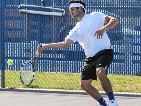 Hammonton's Vincent Maimone returns a serve during