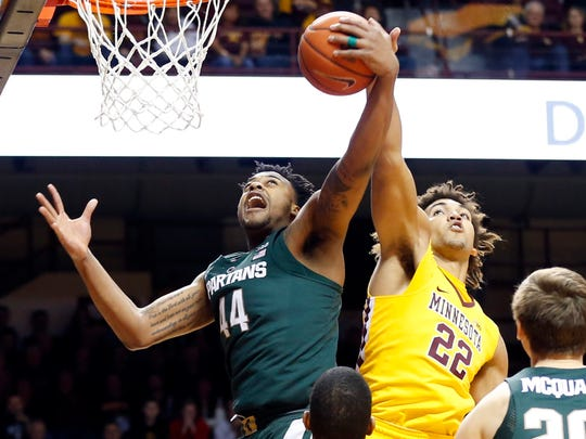 Minnesota's Reggie Lynch, right, tries to knock away
