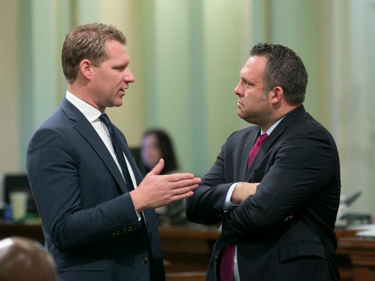 Then-Assembly Minority Leader Chad Mayes, R-Yucca Valley, left, talks with Assemblyman Adam Gray, D-Merced at the Capitol in Sacramento on April 20.