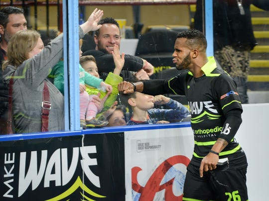 Milwaukee Wave forward Ian Bennett  connects with fans after the Wave's 10-4 victory over the St. Louis Ambush on Saturday, December 16, 2017, at the UW-Milwaukee Panther Arena.