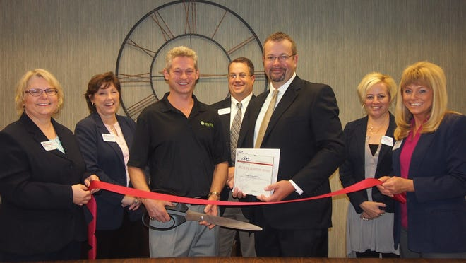 The Fond du Lac Area Association of Commerce held a ribbon cutting at Energy Savings Solutions. In front, from left: Gail Johnson-Daveau, Dental Associates; Mary Weishapple, Gene Zenner, Energy Savings Solutions; Steve Leaman, Horicon Bank; Al Kietzmann, Copier Consulting; Megan Acheson, Lakeland Care District; and Teri Wall, National Exchange Bank & Trust.