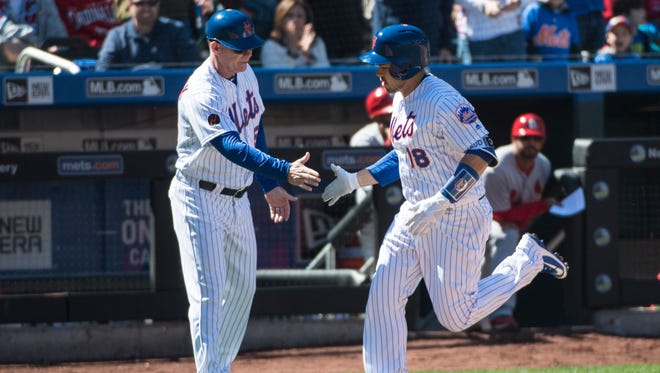 New York Mets catcher Travis d'Arnaud (18) rounds third base after hitting a home run against the St. Louis Cardinals during the 4th inning at Citi Field.