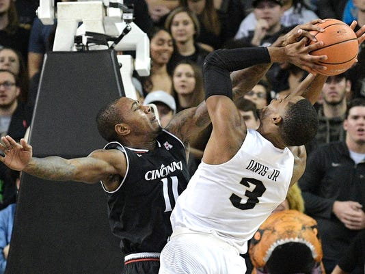 Cincinnati forward Gary Clark (11) blocks a shot by Central Florida forward A.J. Davis (3) during the first half of an NCAA college basketball game Tuesday, Jan. 16, 2018, in Orlando, Fla. (AP Photo/Phelan M. Ebenhack)
