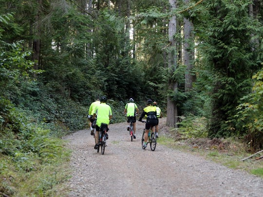 Mountain bikers ride September 2014 at the Ueland Tree Farm in Bremerton.