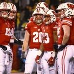 UW players downplay concussion risks as evidence mounts