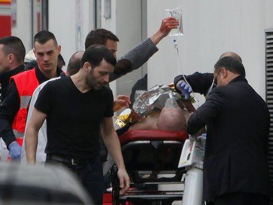 635562300460841282-635562221295067862-AP-France-Newspaper-Attack