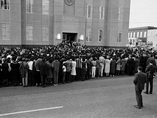 Some 3,500 people gather at the courthouse in Selma, Alabama, on March 16, 1965, for a memorial service for the Rev. James Reeb, a slain Unitarian Universalist minister who was attacked by five white men. Dr. Martin Luther King Jr. led a march from a church about eight blocks away.