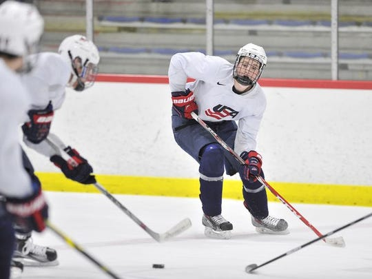 Forward Matthew Tkachuk, right, skates a drill during the U.S. National Under-18 team practice.