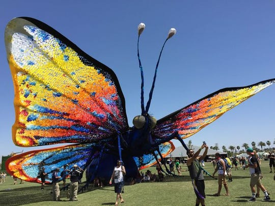 A butterfly spreads its wings at the Coachella Music and Arts Festival on Sunday, April 12, 2015.