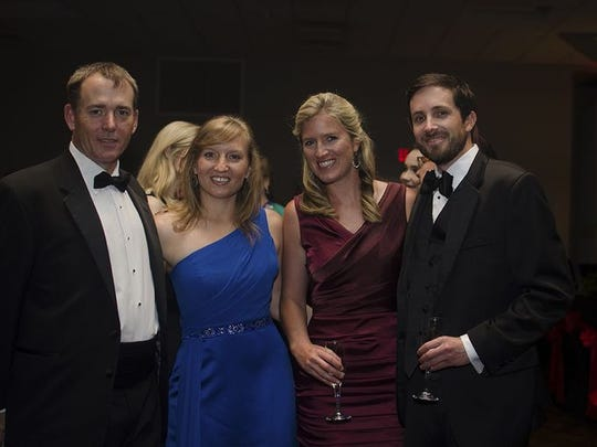 Steve Manning, Angelika Cope, Martina Mains, & Tristan Harper enjoy a past Operazzi Ball. The ball returns Saturday, April 13 at Skopelos at New World.