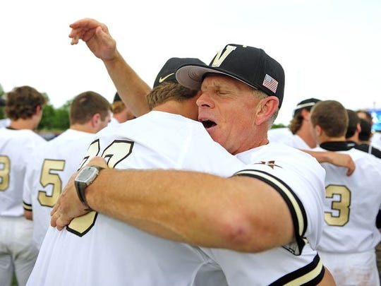 Vanderbilt coach Tim Corbin, right, hugs Matt Ruppenthal after the Commodores defeated Illinois 4-2 in the Game 2 of an NCAA Super Regional on June 8, 2015