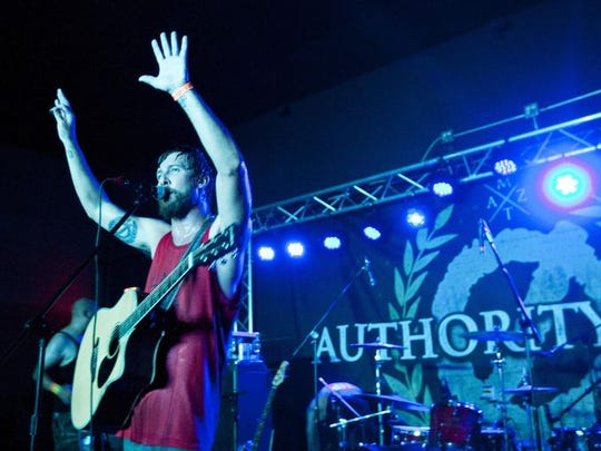 Jason DeVore of Authority Zero plays at the opening new of Club Red's new location in 2014.