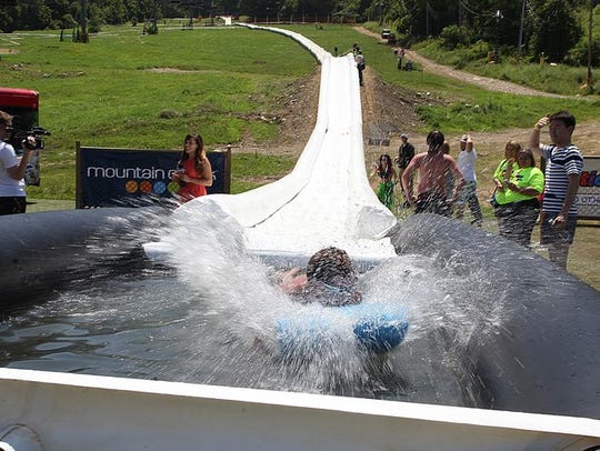 An Action Park employee hits the splash pool at the