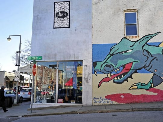A dragon mural is painted on the side of a building
