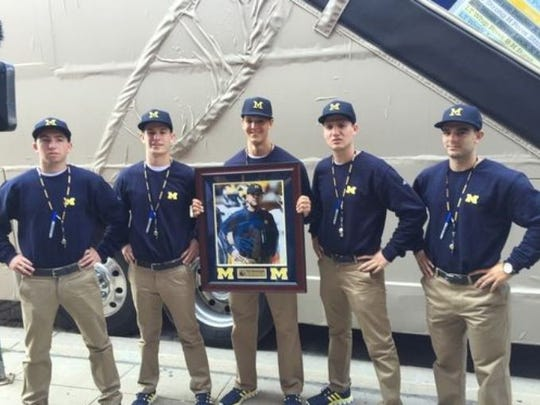 """Aug. 22, 2015: The """"Harbus"""" rolls to Comerica Park in Detroit before the Tigers-Rangers game, including five Jim Harbaugh look-a-likes, courtesy of Fox Sports."""
