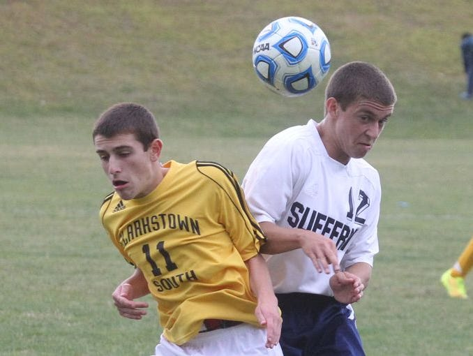 Clarkstown South's Zach Gloskin, left, fights for the ball with Suffern's Ryan Gutmann during their game at Suffern Sept. 16, 2014. Suffern won 1-0.