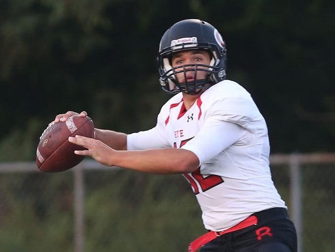 Rye's T.J. Lavelle looks to throw during his team's game at Somers High School on Sept. 4, 2015.