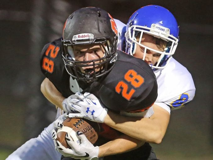 Mamaroneck's Emerson Genovese is tackled by a Mahopac defender at Mamaroneck High School on Sept. 4, 2015.