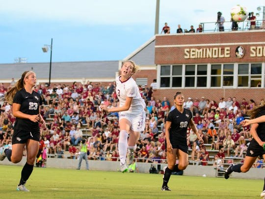 Megan Connolly heads a ball into the net for a goal as FSU defeated UCF 4-0.
